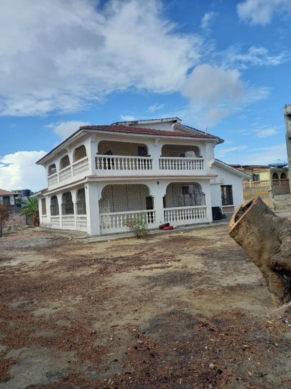 For sale a half-acre commercial land Bamburi with an old house